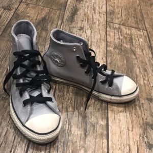 Gray leather converse